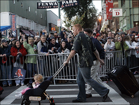 Bobby Kielty & his Daugher walk across Yawkey Way.