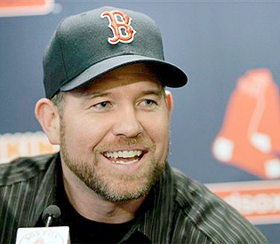 Sean Casey was all smiles in his new Red Sox cap