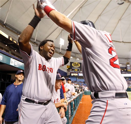 David Ortiz greets Mike Lowell after one of the six Boston jacks on the night