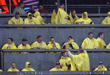 Red Sox fans enjoy the rain during the seventh inning stretch